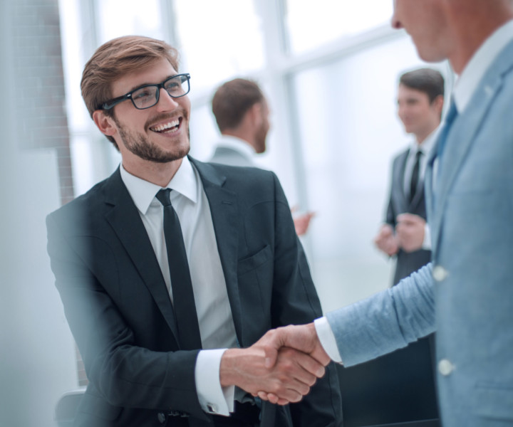 smiling businessman shaking hands with his business partner. concept of cooperation